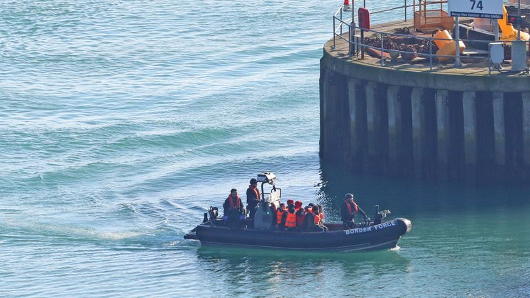 A Border Force boat carrying people thought to be migrants returning to Dover