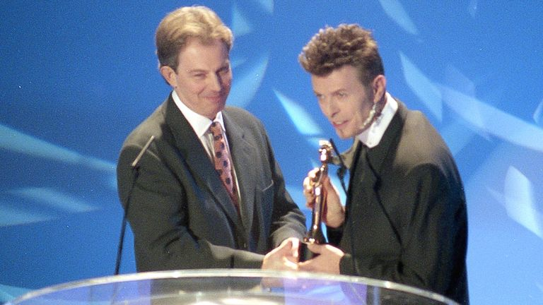 David Bowie wins Outstanding Contribution to Music presented by Tony Blair in 1996. Pic: JM Enternational/Shutterstock
