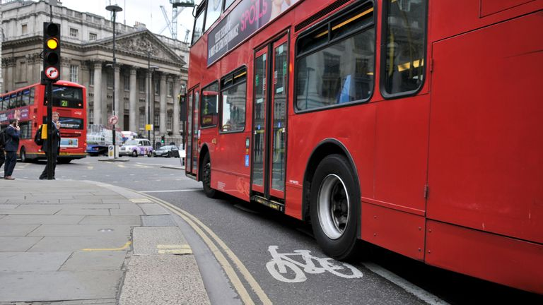 A London bus cuts across a cycle lane on the junction at Bank near the Bank of England on July 28, 2016 in London, England