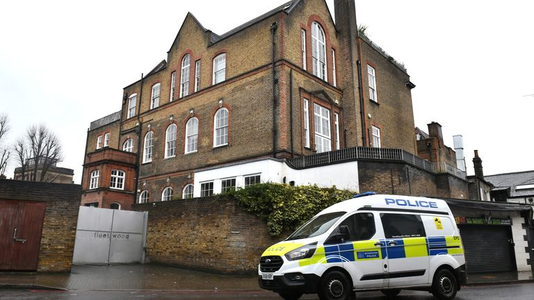A police van parked outside the building believed to be where Caroline Flack lived in Clapton, London