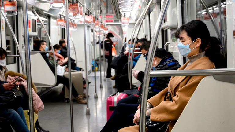 Face masks have become a common sight on public transport in China