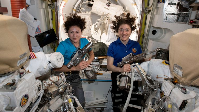 US astronauts Jessica Meir (L) and Christina Koch in the International Space Station