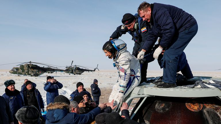 Specialists help NASA astronaut Christina Koch out of the Russian Soyuz MS-13 space capsule after landing in Kazakhstan