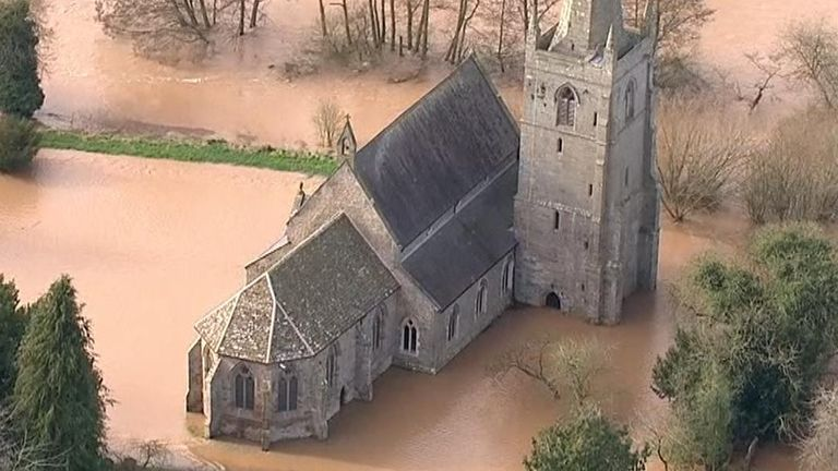 A church in Hereford is surrounded by flood water