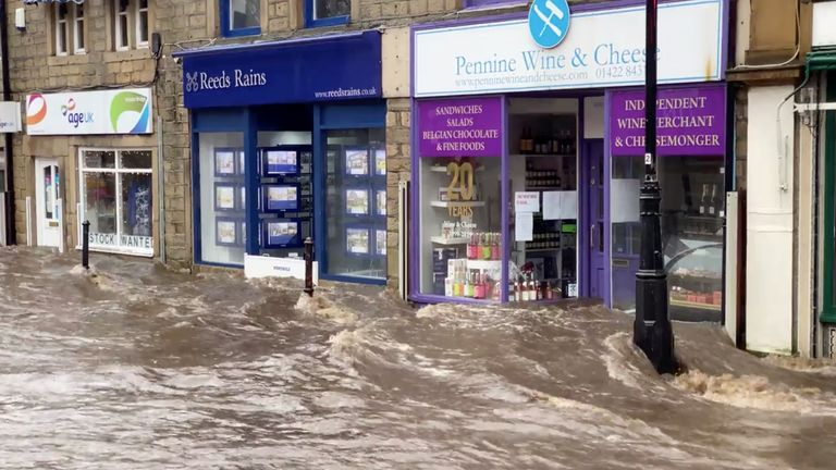 A flooded street is seen after Storm Ciara downpour in Hebden Bridge, West Yorkshire, Britain February 9, 2020. Pic: THE AFGHAN RUG SHOP