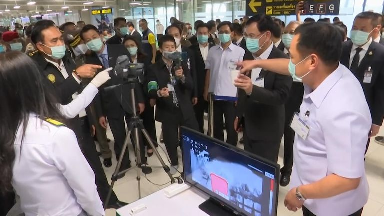 Thermal scanners screen arriving airline passengers in Thailand