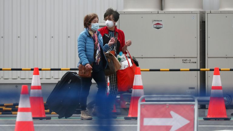 Some passengers were seen getting into taxis after being allowed to disembark the ship