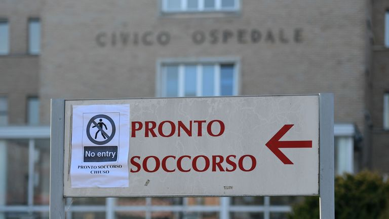 "A sign reading ""Emergency Department Closed"" at the entrance to a hospital in Codogno"