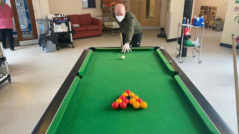 Kharn Lambert plays pool inside the coronavirus quarantine in Merseyside