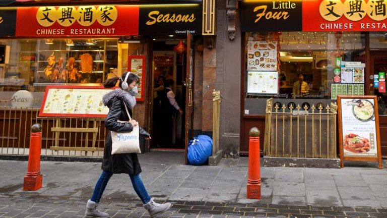 A woman wears a mask in London's China Town - but there have only been two cases identified in the UK so far