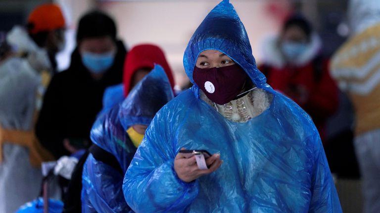 Passengers wearing masks outside Shanghai railway station
