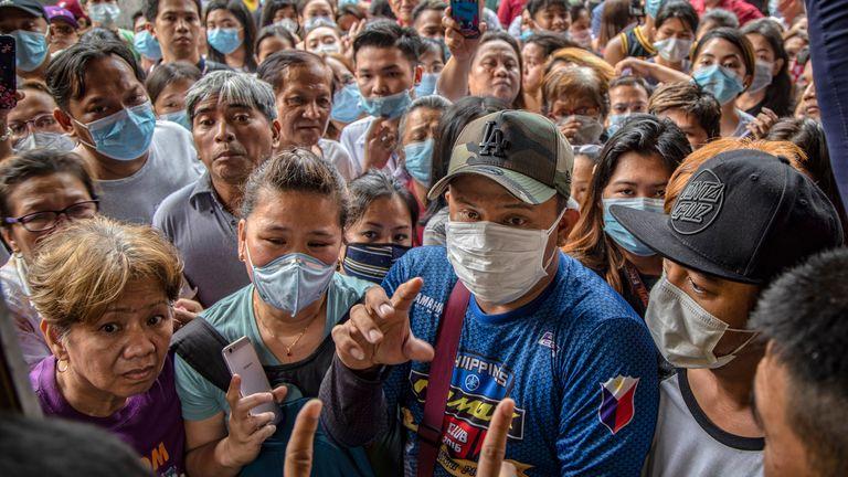 Filipinos hoping to buy face masks