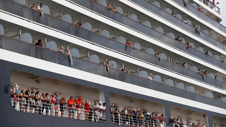 Passengers on the MS Westerdam waved their towels before disembarking in Cambodia