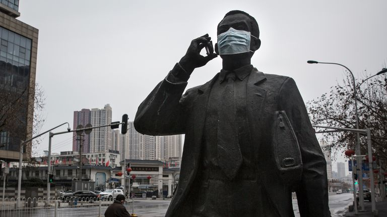 A protective mask was placed on a statue outside in Wuhan