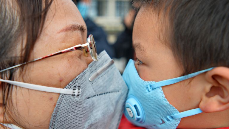 A doctor kisses her five-year-old son goodbye before leaving Shaoxing to join the battle against coronavirus