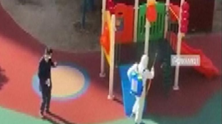 Disinfectant in sprayed on a playground in Wuhan