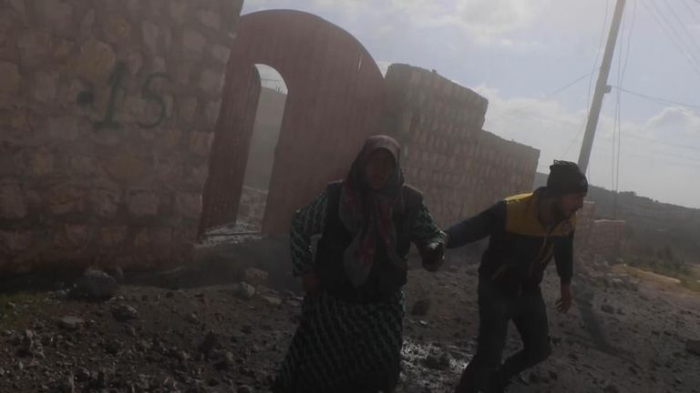 The White Helmets helped an old woman out of her house after it was bombed