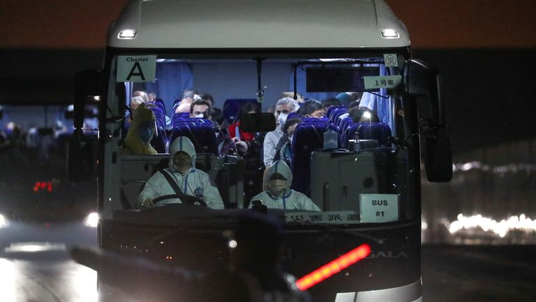 Evacuated US passengers seen on a shuttle bus