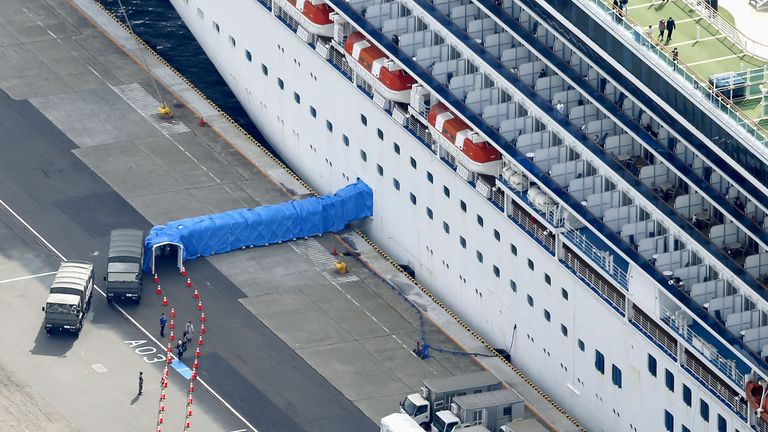 Passengers can be seen disembarking the Diamond Princess