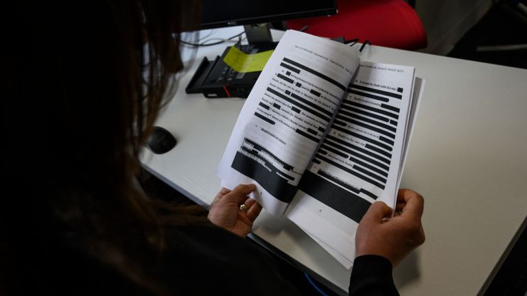 A journalist reads a redacted court filing from the Special Council Robert Mueller in the Paul Manafort case on April 16, 2019. - The final report from Special Counsel Robert Mueller's Russia investigation on April 18, 2019, could leave much of the public unsatisfied because it could be heavily redacted, stripped of significant evidence and testimony that the investigators gathered. Attorney General Bill Barr made clear he will edit out large parts of Mueller's 400-page final report on his inves