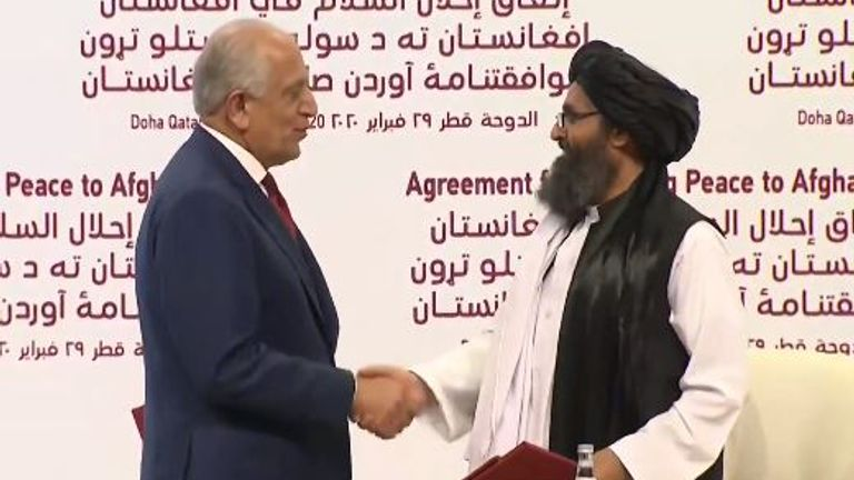 A peace deal between the US and its once sworn enemy the Taliban has been sealed at twin ceremonies