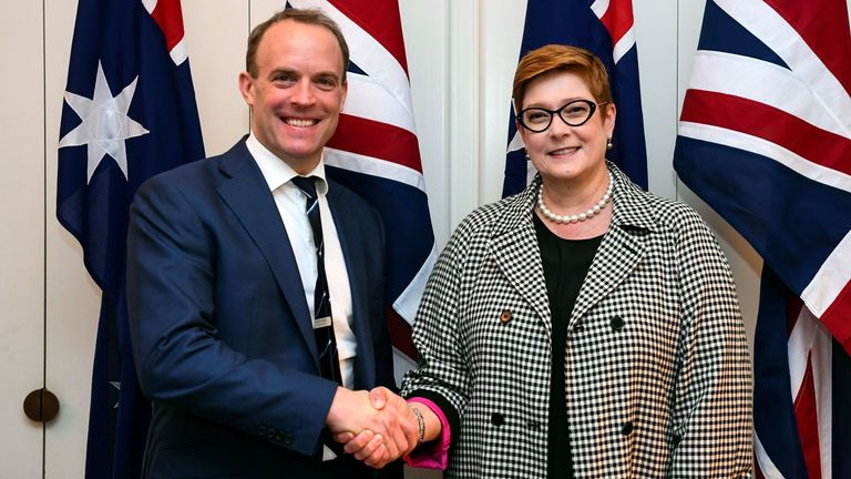 Australia's Foreign Minister Marise Payne shakes hands with Britain's Foreign Secretary Dominic Raab