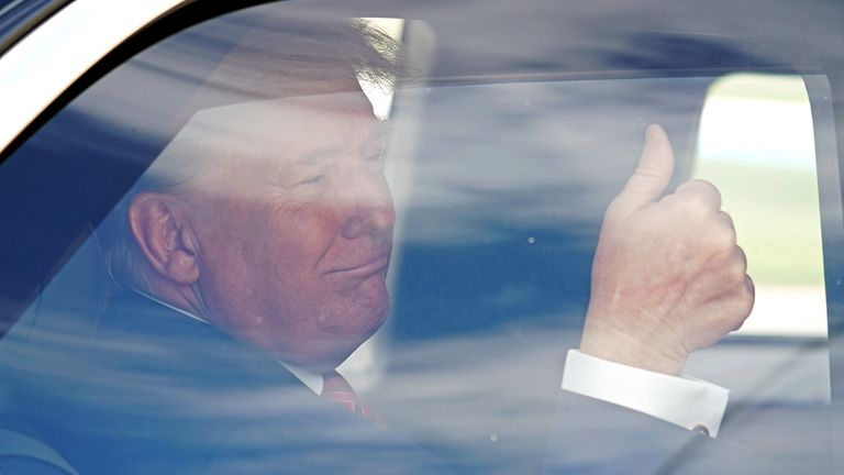 The president gave a thumbs-up from his limousine