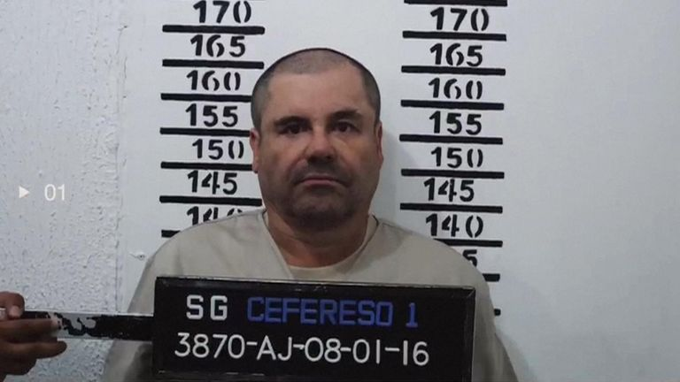 "Clad in a beige uniform marked ""3870,"" the captured drug kingpin answered the Mexican prison guard's questions calmly, barely looking up as he scrubbed black fingerprint ink from his hands."