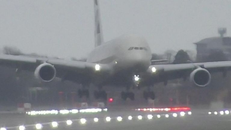 An Airbus A380 plane is shown hovering above tarmac as it attempted to touch the runway at London Heathrow airport.