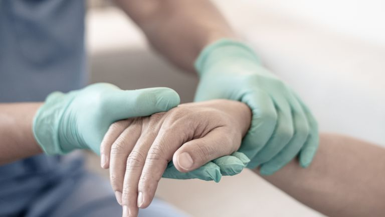 Surgeon, physician performs surgical operations, anesthetist or anesthesiologist holding patient's hand ffor checking state of mand or support in ER room, Medical healthcare concept