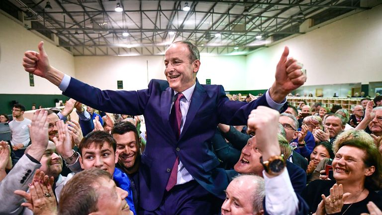 Fianna Fail leader Micheal Martin celebrates being re-elected to parliament