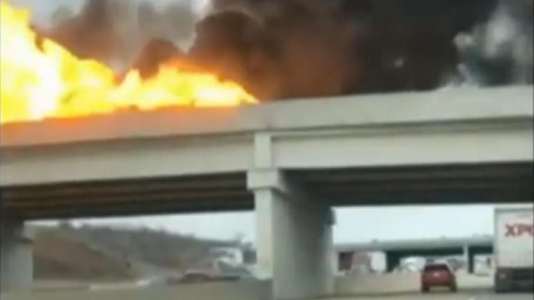 A semi-truck carrying fuel overturned and caught fire on an interstate in Indianapolis, Indiana, closing highway lanes in both directions on Thursday, February 20, according to local media.