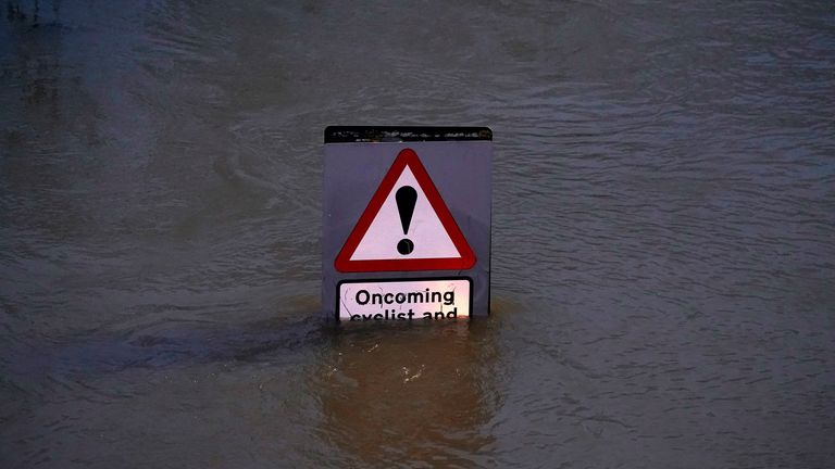 A street sign is part submerged by floodwater in Shrewsbury