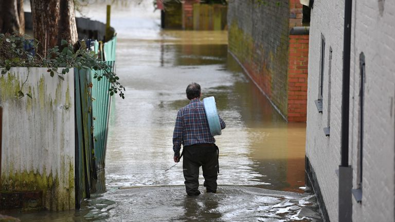 A man wades back to his property in Shrewsbury