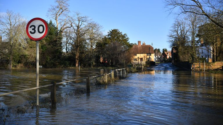 A flooded street is seen in Yalding, southeast of London, on December 23, 2019. - Flood warnings remain in place across England. (Photo by Ben STANSALL / AFP) (Photo by BEN STANSALL/AFP via Getty Images)