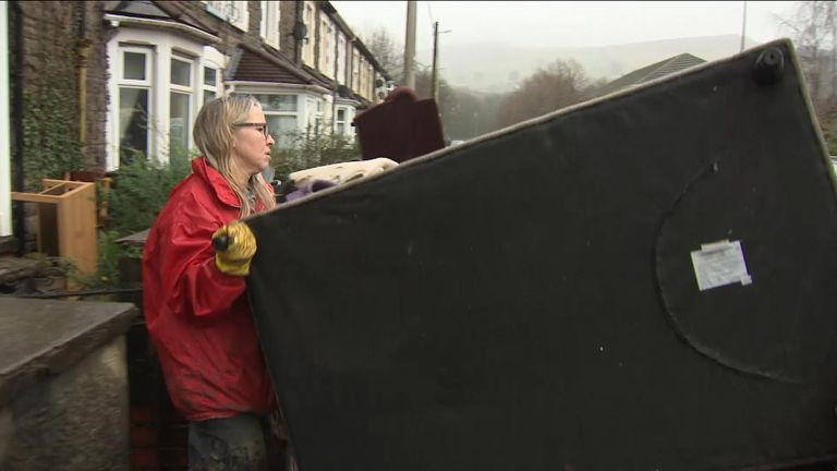 Residents in South Wales remove property damaged by floods