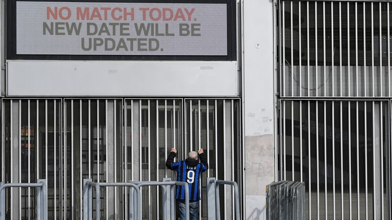 A man stands outside the San Siro stadium after the Inter Milan v Sampdoria Serie A match was cancelled due to an outbreak of the coronavirus in Lombardy and Veneto, in Milan, Italy, February 23, 2020