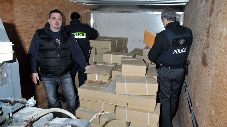 Bourassa is seen in the back of the truck that contained $200m in forged US bank notes