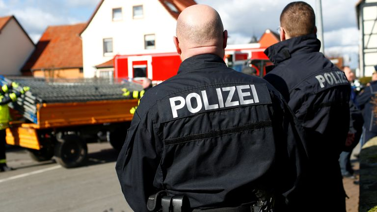 Police near the crash scene after a car was driven into a Carnival parade, injuring several people in Volkmarsen, Germany