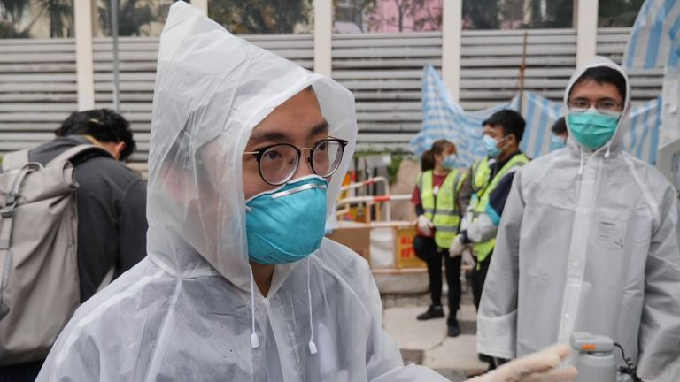 The virus vigilantes wear protective gear while checking new arrivals to Hong Kong