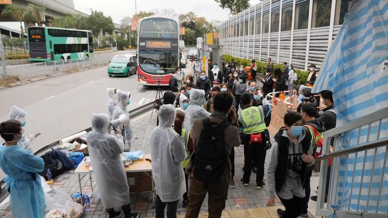 People arriving by bus are being checked on their way into the territory