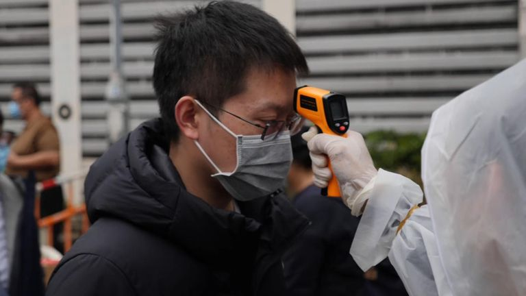 The virus vigilantes are checking the temperatures of new arrivals