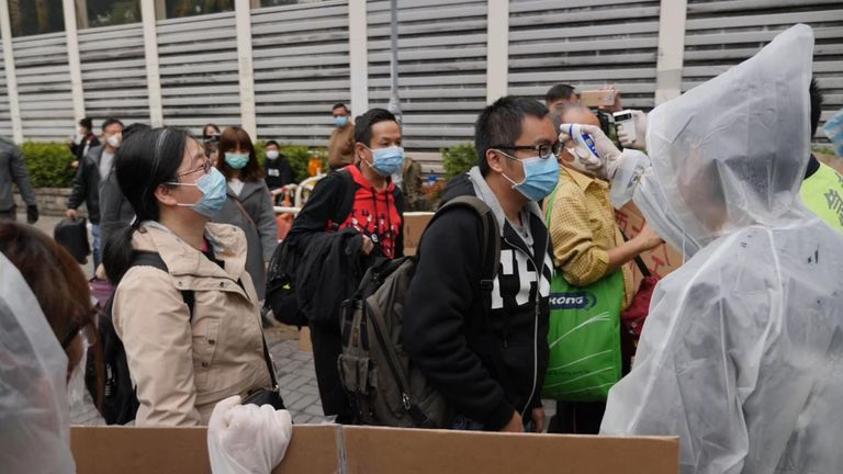 Visitors the from the mainland have been seen wearing masks as they enter Hong Kong