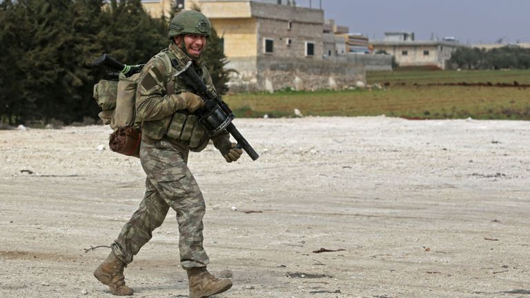 A Turkish soldier patrols the countryside in Syria's Aleppo province