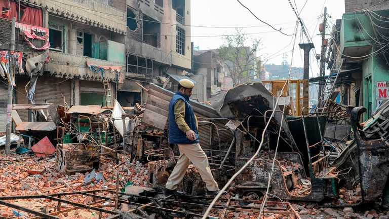 Days of rioting have left houses and businesses in New Delhi damaged
