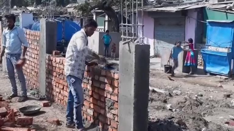A wall is being built in India along a route Donald Trump will take when he visits and some say it is designed to hide poor people