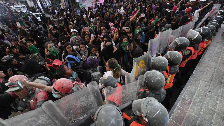 Protesters clash with police as women march in Mexico City, on February 14, 2020, to protest gender violence. - Several protests convened on Friday in the Mexican capital and other cities of the country after the murder of Ingrid Escamilla, 25, stabbed to death and then skinned by her partner in the north of Mexico City on February 9