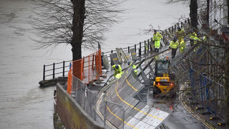 Environment Agency teams work on temporary flood barriers in the Wharfage area of Ironbridge, Shropshire, after floodwaters receded following an emergency evacuation of some properties earlier this week. PA Photo. Picture date: Friday February 28, 2020. See PA story WEATHER Storm. Photo credit should read: Matthew Cooper/PA Wire