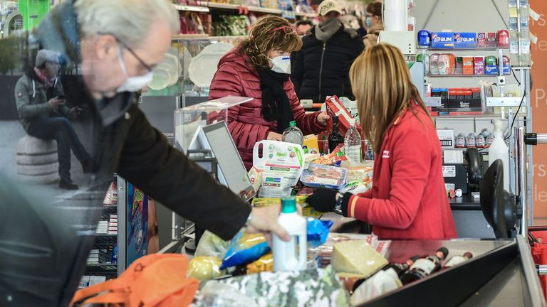 Residents shop in a supermarket in small groups of forty people on February 23, 2020 in the small Italian town of Casalpusterlengo