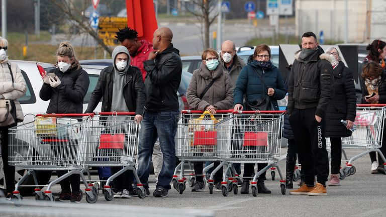 People queue at a supermarket outside the town of Casalpusterlengo, which has been closed by the Italian government due to a coronavirus outbreak in northern Italy, February 23, 2020
